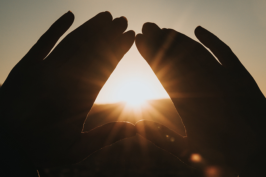 Sun Rays Through Hands