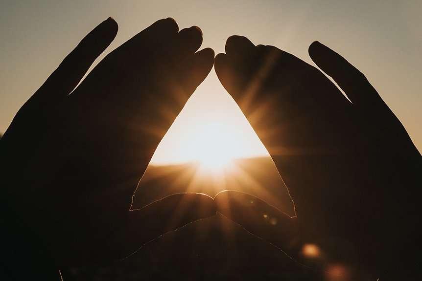 Sun Rays Through Hands